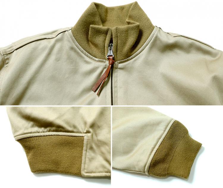 ①「襟や袖、裾にニットリブをあしらって遮風性を向上!」